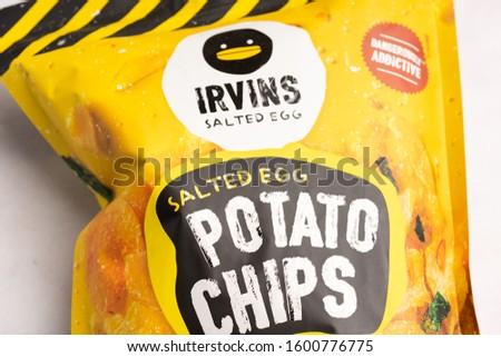 Kuala Lumpur, Malaysia - December 2019. Irvins Salted Egg Potato chips is a famous Singaporean food #1600776775