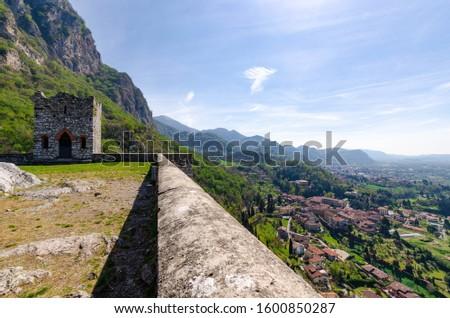 a beautiful small fort or castle called castello dell'innominato #1600850287