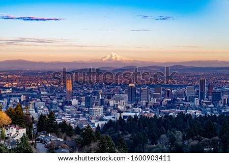 Portland, Oregon seen toward the east with Mt. Hood towering in the background in the sunset.