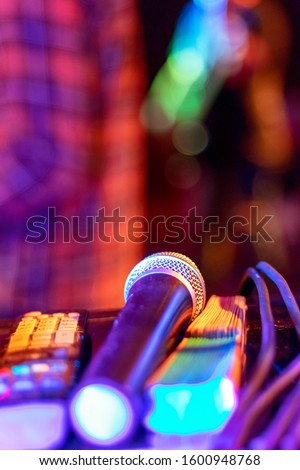 Public performance on stage Microphone on stage against a background of auditorium. Shallow depth of field. Public performance on stage. #1600948768