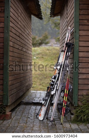 Skis supported on the wall of the house. winter sports. winter holidays. #1600973404