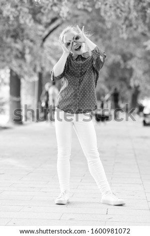 Time to fun. Little child have fun doing glasses gesture outdoor. Small girl enjoying summer fun. Fun activities that make her happy and cheerful. #1600981072