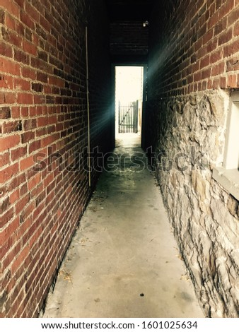 Alley Way in Gettysburg Pennsylvania with bullet holes in the wall #1601025634