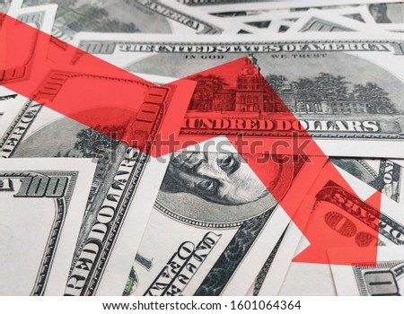 The light red arrow icon on a background of money. The concept of changing course of US dollar on the market. Devaluation, collapse, stagnation of the economy.Finance and economics. #1601064364