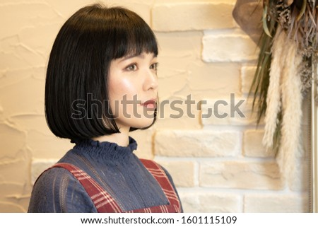 Bob cut black hair woman. #1601115109
