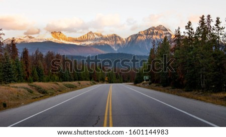 A road is a long piece of hard ground which is built between two places so that people can drive or ride easily from one place to the other. There was very little traffic on the roads. #1601144983