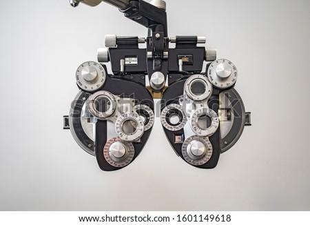 Phoropter used for eye examination to measure refractive error to determine eyeglass prescriptions #1601149618