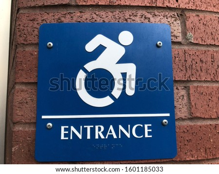 Progressive Handicapped Person Sign Depicting Person I'm wheelchair moving quickly — ADA compliant sign and health sign