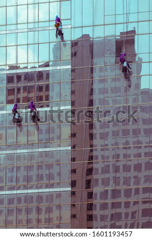 window washers on a highrise office building, sweet tone filter effect #1601193457