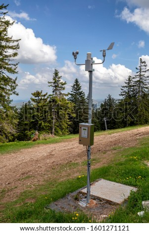 Weather station on the top of mountain with anemometer and wind vane. #1601271121