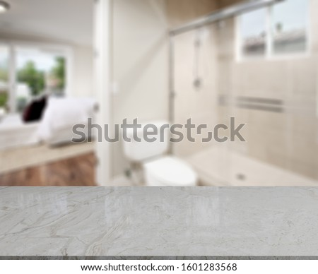 Empty marble top table with blurred bathroom interior Background. for product display montage. #1601283568
