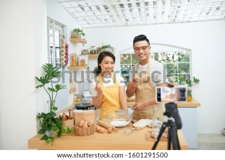 Couple making dough together, baking and cooking concept rustic style photo for cook book and cook blog #1601291500