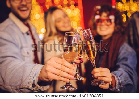 Close view of group of happy friends drinking champagne and celebrating New Year at the street. New year party. #1601306851