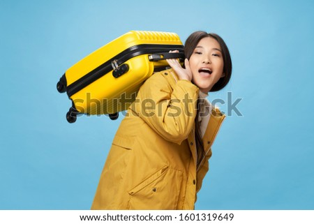 Woman with yellow suitcase on vacation vacation travel passenger lifestyle #1601319649