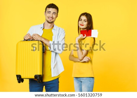 Cheerful man and woman yellow suitcase on travel vacation passport airplane tickets #1601320759