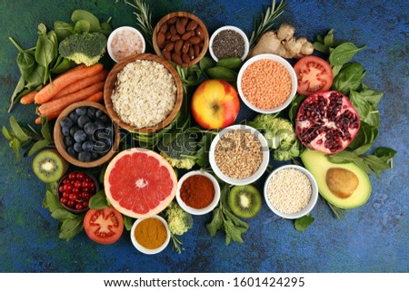 Healthy food clean eating selection: fruit, vegetable, seeds, superfood, cereals, leaf vegetable on background #1601424295