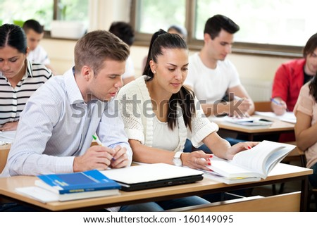 colleagues students studying together in classroom  #160149095
