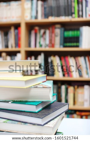 Stack of books in library #1601521744