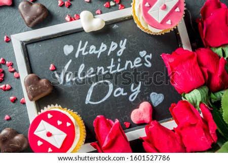 Valentine's day greeting card. Sweet Valentine's creative dessert food. Homemade pink and red  delicious cupcakes with decor of Valentine day symbols #1601527786