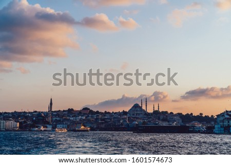 Istanbul old city with Galata promenade from ferry boat. View from Bosphorus water, cityscape with Mosque pics