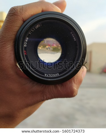 DSLR lens Holding in Hand - Captured in Naushehra, Pakistan...Dated 11,Dec,2019 #1601724373
