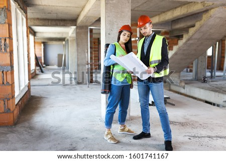 architects with blueprints. construction site engineers with project. satisfied expressions #1601741167