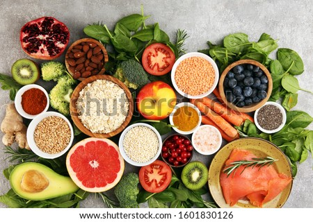 Healthy food clean eating selection: fish, fruit, vegetable, cereal, leaf vegetable on background #1601830126
