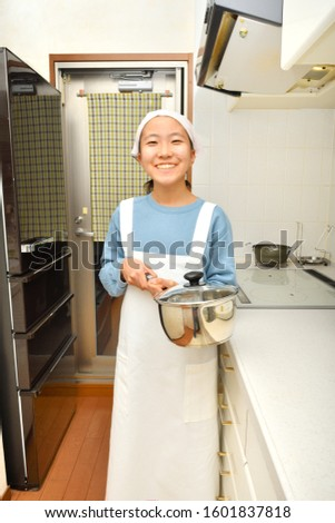 Japanese girl smiling in the kitchen #1601837818