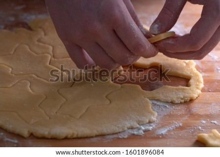 Cut cookies from rolled dough.