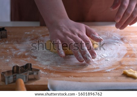 Cut cookies from rolled dough.Cook cuts cookies out of rolled dough. #1601896762