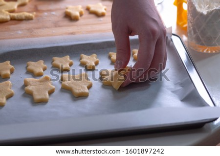 Cut cookies from rolled dough.Cook cuts cookies out of rolled dough. #1601897242