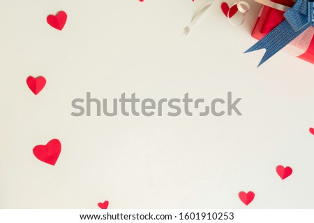Top view Valentine day set of gift red boxes,with blue bow and ribbon, with paper heart shape,on white background,concept Celebrating festival symbolizes day of love,with copy space for text input. #1601910253