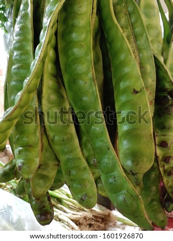 bitter beans sold by vegetable traders in traditional markets #1601926870