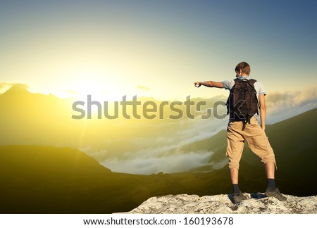 Tourist on the rock. Sport and active life concept #160193678