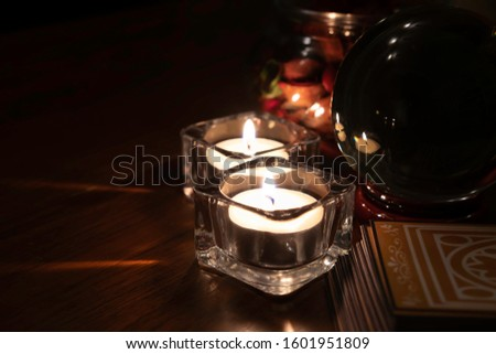 Burning candles light with deck of tarot cards and crystal ball on background. Mystic and forecasting concept. #1601951809