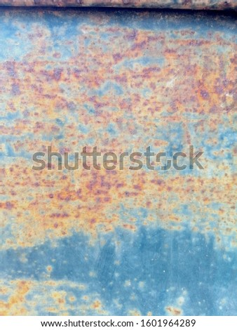 Rustic on the old wall background. Rust wall. Rust effected to wall. Rust. Rust background #1601964289
