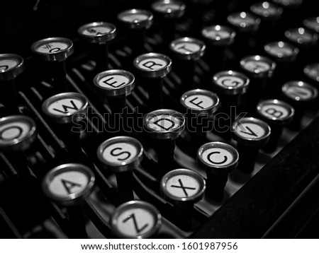 Close-up detail of the keyboard of old vintage typewriter, black and white style. #1601987956