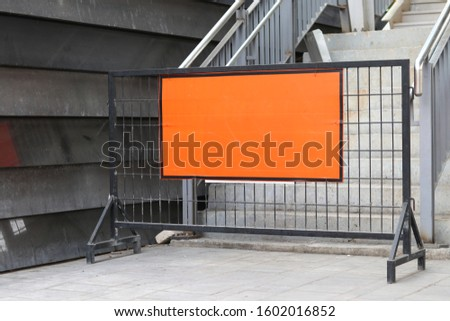 Steel barrier with orange label placed across the stairs. #1602016852