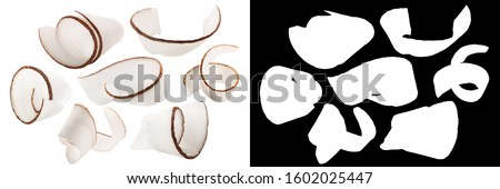 Coconut shavings, curls or rolled up slices of kernel meat, isolated with mask #1602025447
