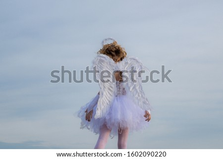 Innocent girl. Enjoying magic moment. Valentines day card. Cute teen cupid on the cloud - sky background #1602090220