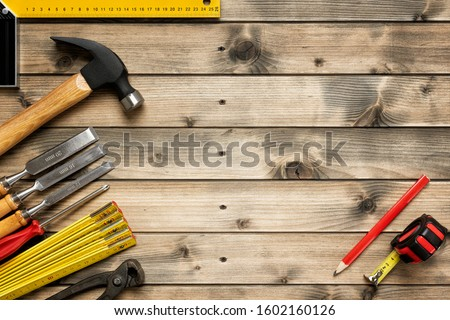 Top view of carpenter work tools on an antique wooden table. Construction industry, do it yourself. Text space. #1602160126