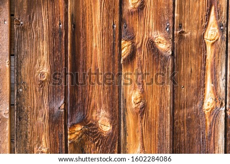 Exterior wall of old weathered wood background #1602284086