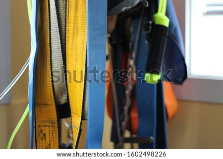 Assorted Workout Equipment Hanging from Rack #1602498226