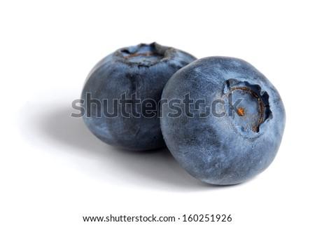 Extreme close-up image of blueberries on white background #160251926