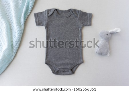 Baby Bodysuit Mockup, Gray Baby Bodysuit with rabbit toy - Gender Neutral Mock Up - Styled Stock Photography #1602556351