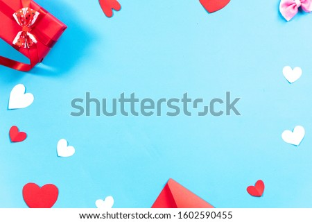 Valentines Day background. Gifts, envelope,white and red hearts on pastel blue background. Valentines day concept.Top view, copy space. #1602590455