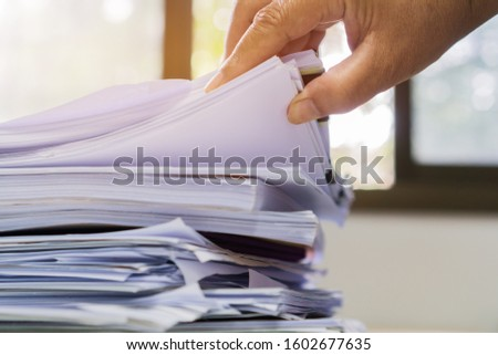 Businesswoman hands working on Stacks of documents files for finance in office. Business report papers or Piles of unfinished document achieves with black clip paper. Concept of Business Annual Report #1602677635