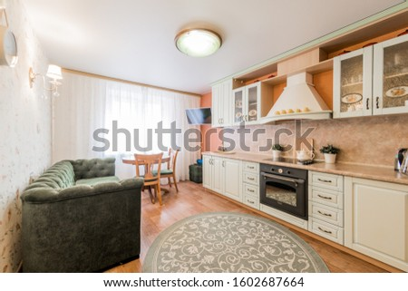 Russia, Moscow- August 05, 2019: interior room apartment modern bright cozy atmosphere. general cleaning, home decoration, preparation of house for sale. kitchen, dining area #1602687664