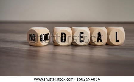 Cubes and dice with good deal or no deal on wooden background #1602694834