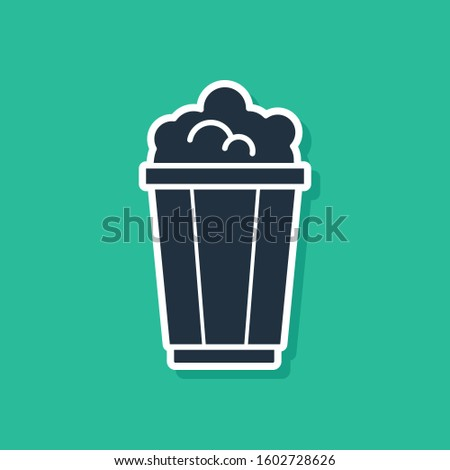 Blue Popcorn in cardboard box icon isolated on green background. Popcorn bucket box.   #1602728626